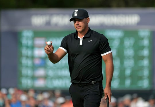 Brooks Koepka makes a putt on the 13th green during the third round.