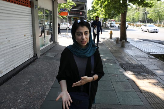 "Civil servant and student Afra Hamedzadeh speaks during an interview in downtown Tehran, Iran. ""Trump is not predictable at all and one doesn't know how to react to him and what is the right thing to do against him,""she says. ""Since he controls the global economy we are somehow left with few options."""