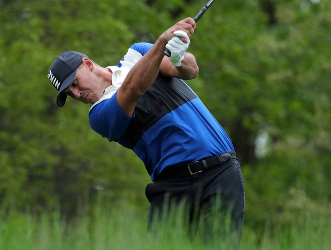 Brooks Koepka drives off the seventh tee during the final round of the PGA Championship on Sunday.
