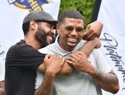 Jimmy King, here hugging fellow Fab 5 member Jalen Rose last year at a golf outing, joined Rose in supporting Juwan Howard as a candidate to replace John Beilein as Michigan basketball coach.