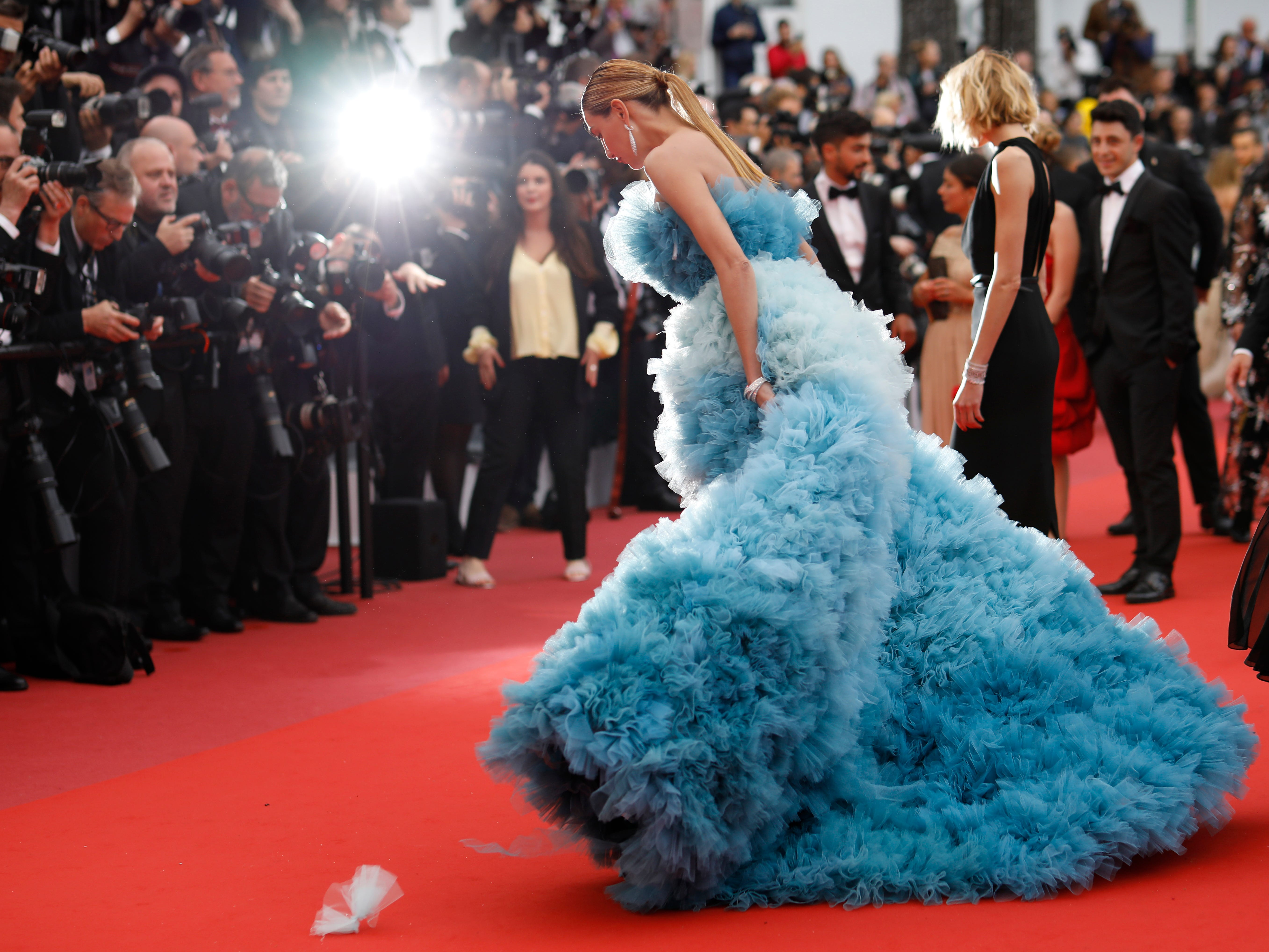 """Model Alina Baikova poses for photographers upon arrival at the premiere of the film """"A Hidden Life"""" at the 72nd international film festival, Cannes, southern France, Sunday, May 19, 2019."""