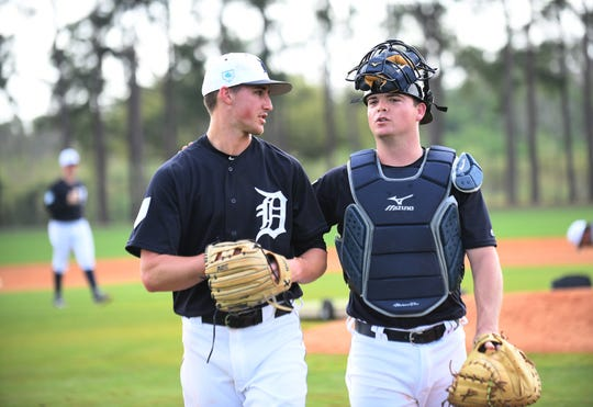 Jake Rogers, right, chats with pitcher Zac Reininger during the spring.