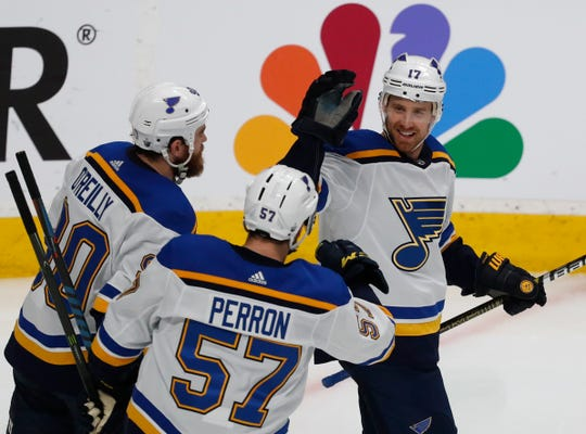 St. Louis's Ryan O'Reilly (90) and David Perron (57), celebrate with Jaden Schwartz, who scored a goal against the San Jose Sharks on Sunday.