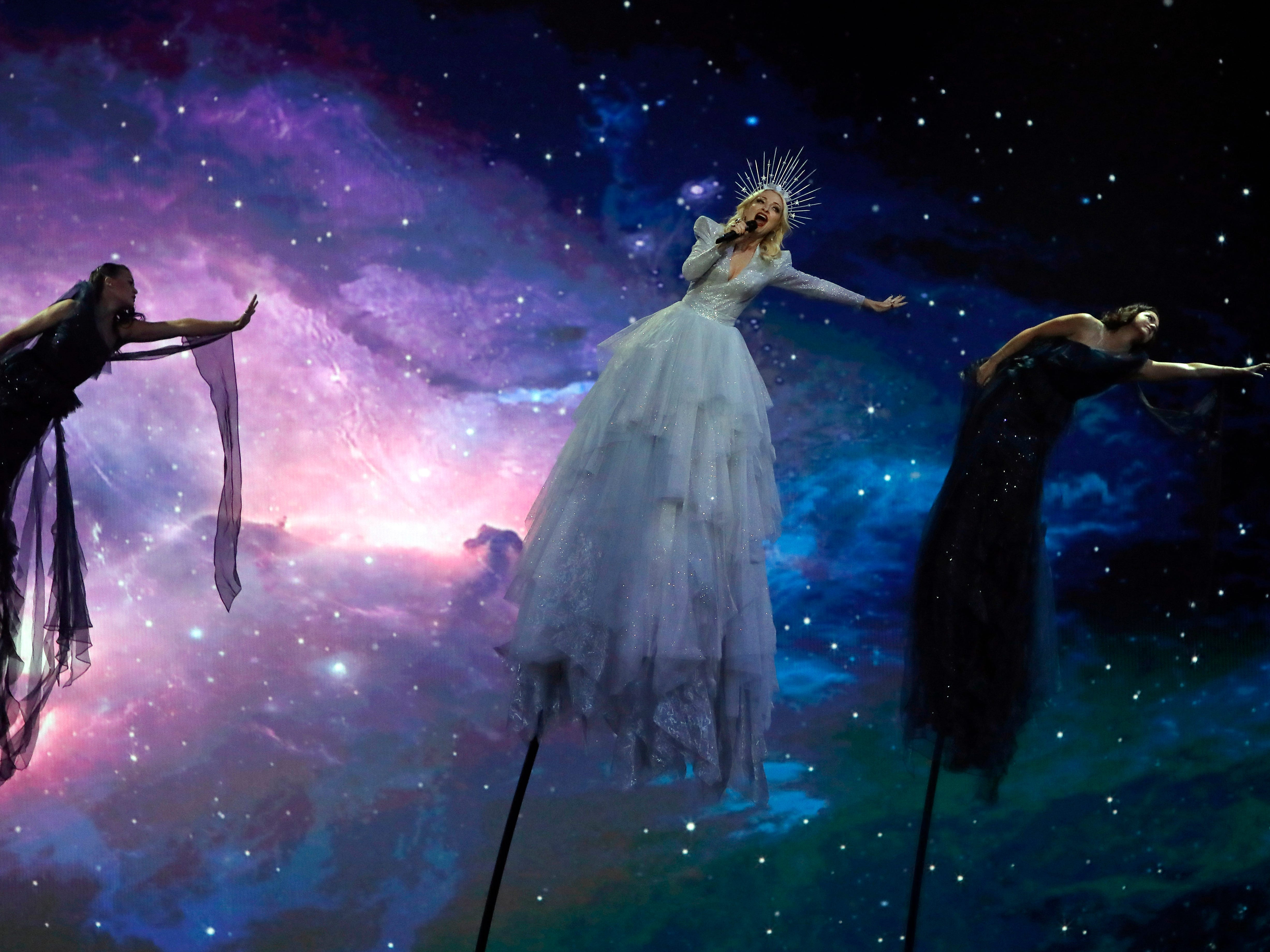 """Kate Miller-Heidke of Australia, center, performs the song """"Zero Gravity"""" during the 2019 Eurovision Song Contest grand final in Tel Aviv, Israel, Saturday, May 18, 2019."""