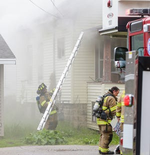 Fond du Lac Fire/Rescue members work the scene of a house fire Sunday, May 19, 2019, at 29 Woods Place in Fond du Lac, Wis.