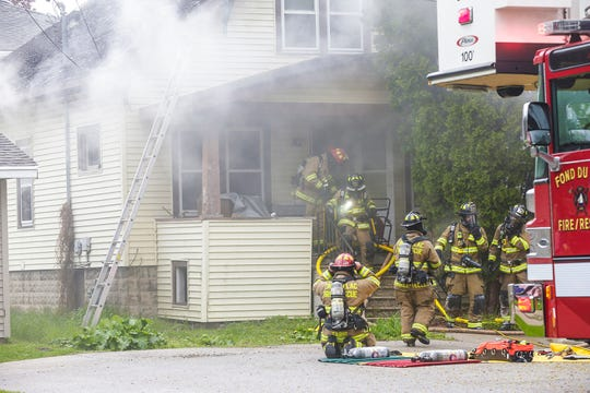 Fond du Lac Fire/Rescue members work the scene of a house fire Sunday, May 19, 2019 at 29 Woods Place in the City of Fond du Lac, Wis. Doug Raflik/USA TODAY NETWORK-Wisconsin