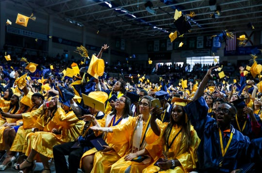 Graduates toss their caps in the air at the end of their graduation. Lehigh Senior High School walked in style as they graduated Saturday morning during their  graduation ceremony at Alico Arena, Estero, FL. About 400 students participated in the ceremony.