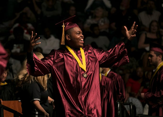 Riverdale High School senior Travian Black celebrates as he walks across the stage at graduation on Sunday, May 19, 2019, at Hertz Arena in Estero.