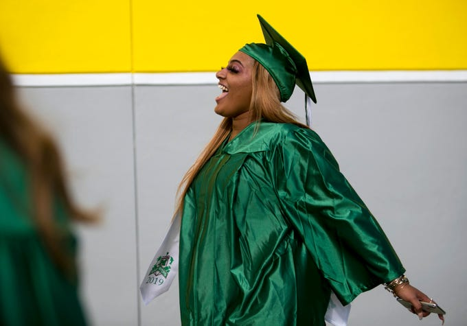 Fort Myers High School senior Ta'riahaya Fuller arrives for graduation on Sunday, May 19, 2019, at Hertz Arena in Estero. About 460 students participated in the ceremony.