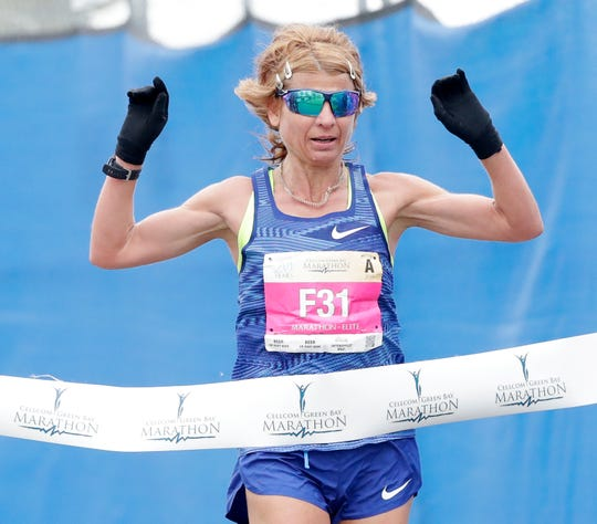 Valentyna Poltavska wins the women's race in the Cellcom Green Bay Half Marathon on Sunday.