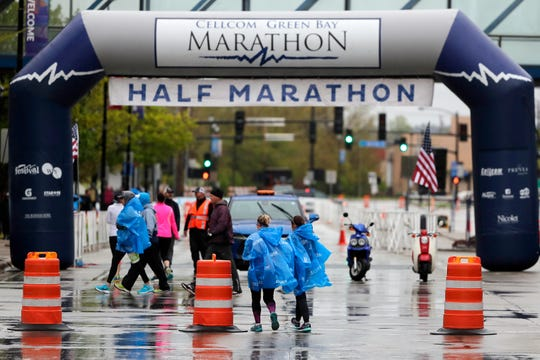 Runners arrive at the start of the half marathon on Sunday, May 19, 2019, in Green Bay, Wis.