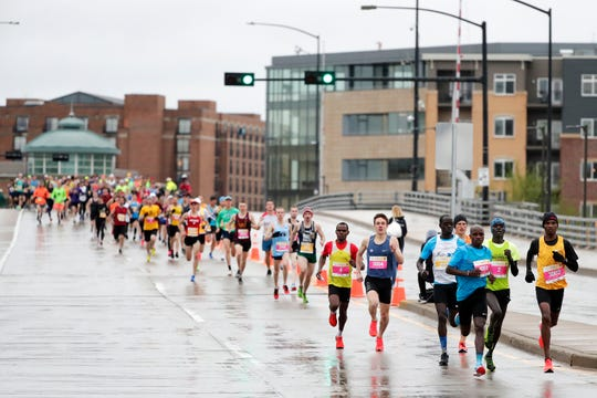 Runners start the Cellcom Green Bay Half Marathon on Sunday.