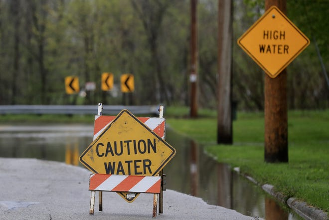 Cass Street is closed due to floodwaters from the East River on Sunday in Green Bay.