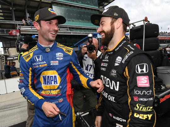 Alexander Rossi (27) shares a laugh with James Hinchcliffe following his qualifying run for the Indianapolis 500 on Bump Day at the Indianapolis Motor Speedway on Sunday, May 19, 2019.