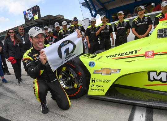 Simon Pagenaud (22) of Team Penske celebrates winning the pole position for the Indianapolis 500 on Bump Day at the Indianapolis Motor Speedway on Sunday, May 19, 2019.