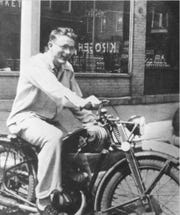James Dean sits on Main Street in Fairmount on the motorcycle his uncle gave him for his 16th birthday .