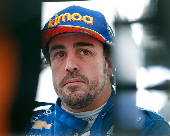 Fernando Alonso (66) of McLaren Racing talks to his team following their morning practice for the Indianapolis 500 at the Indianapolis Motor Speedway on Sunday, May 19, 2019.