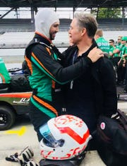 Kyle Kaiser gets a word of encouragement from his dad, Jeff Kaiser, Sunday, May 19, before his final qualifying attempt.