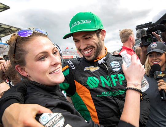 Kyle Kaiser (32) of Juncos Racing (with his girlfriend Liz Van Oostenburg) earned the final Indy 500 starting spot on the final Last Row Shootout attempt. He's on the outside of Row 11.