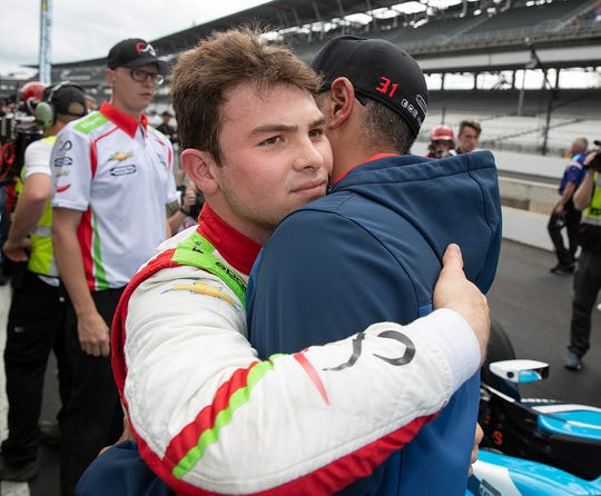 Patricio O'Ward of Team Carlin Racing hugs a crew member failing to make the field of 33 cars for the Indianapolis 500 on Bump Day at the Indianapolis Motor Speedway on Sunday, May 19, 2019.