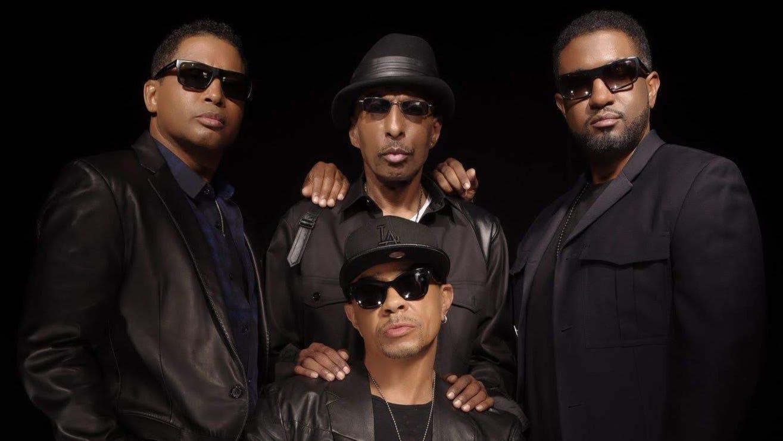 R&B singer Melvin Edmonds, center of top row,...