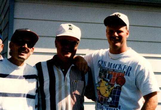 Charlie (left to right), Scott and Sam McAtee at the Indianapolis 500 in the mid-1990s.