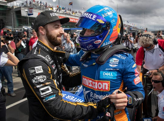 James Hinchcliffe, left, hugs Fernando Alonso (66) of McLaren Racing after his qualifying run for the Indianapolis 500 at the Indianapolis Motor Speedway on Sunday, May 19, 2019.