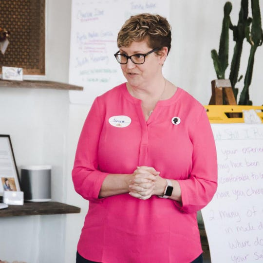 Booth Andrews is a business coach with a heavy emphasis on incorporating wellbeing into life and business.