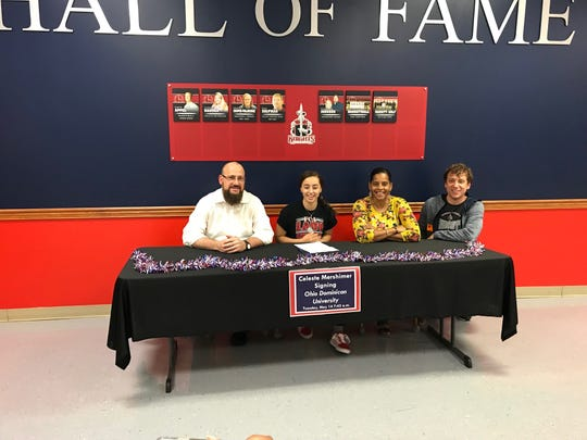 Fairfield Christian Academy's Celeste Mershimer signs her letter of intent to play basketball at Ohio Dominican University. She scored more than 1,600 career points and was a three-time All-Ohio honoree. She is seated with her parents, Gerald and Nikki Mershimer and Fairfield Christian coach Ben Bethel.