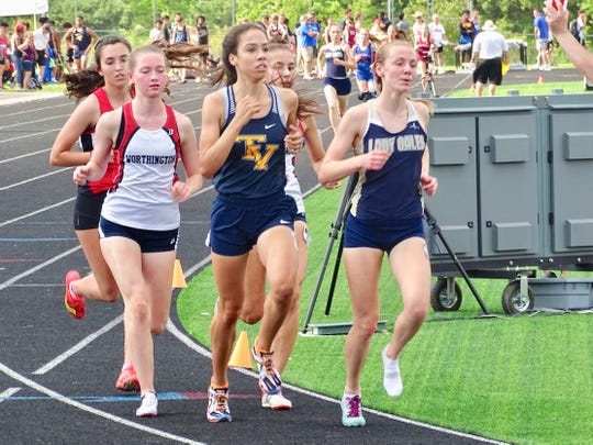 Even though she lost her shoe on the first lap, Lancaster's Elise Johnson still managed to finish second in the 3,200 during Saturday's Division I district meet at Hilliard Darby.
