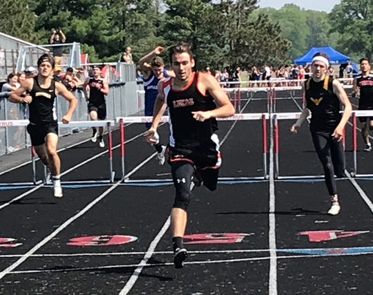 Lucas senior Danny Desterhaft wins the 300 hurdles after already claiming the 110 highs in Saturday's Division III district track and field meet.