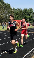 Leo Ringler wins the 3200 as Crestview's boys rallied to nip Colonel Crawford for the Division III district championship.