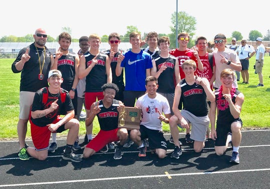 Coach Tim Kuhn and his Crestview Cougars after winning the Division III district track and field title at Bucyrus High School.