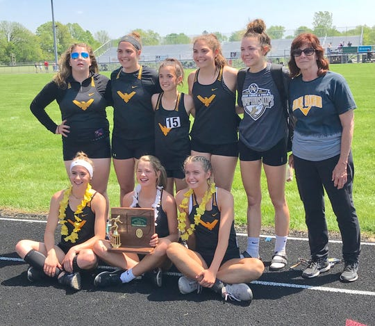 Jody Grove has coached three state title-winning girls teams on the track side.