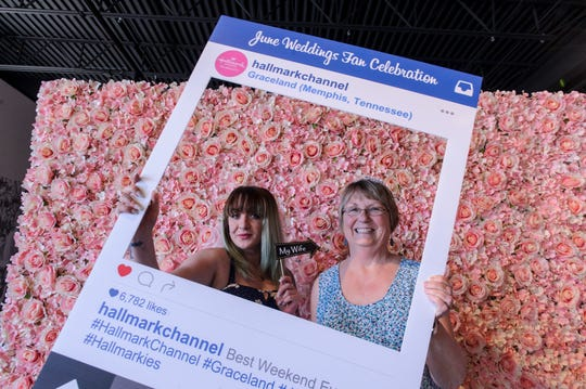 Brittany Clark, left, and Penny Crowley pose for a photo during a Hallmark party in Graceland on Saturday, May 18, 2019, in Memphis, Tenn.
