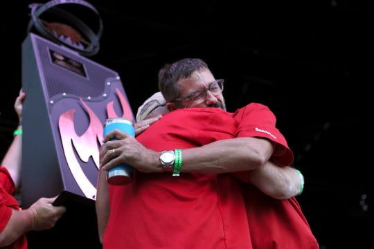 Pitmaster Tuffy Stone hugs his Cool Smoke teammates after they are announced as the Grand Prize winners in a culmination of the Memphis in May World Championship Barbecue Cooking Contest in Tom Lee Park on Saturday, May 18, 2019