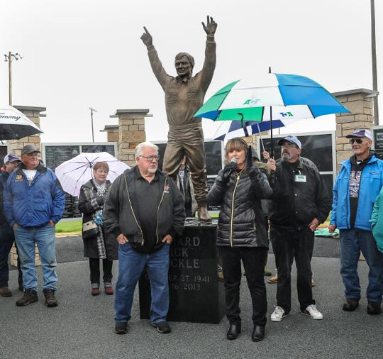 Vicky Bowman addresses a crowd of several hundred gathered for the dedication of a statue of her father, late racing legend Dick Trickle, at the community park in his hometown of Rudolph. To the left of the statue is Chuck Trickle, Dick's brother.