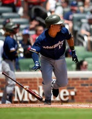 Milwaukee Brewers' Keston Hiura watches his home run go toward left field during the fifth inning of a baseball game against the Atlanta Braves, Sunday, May 19, 2019, in Atlanta. (AP Photo/John Amis)