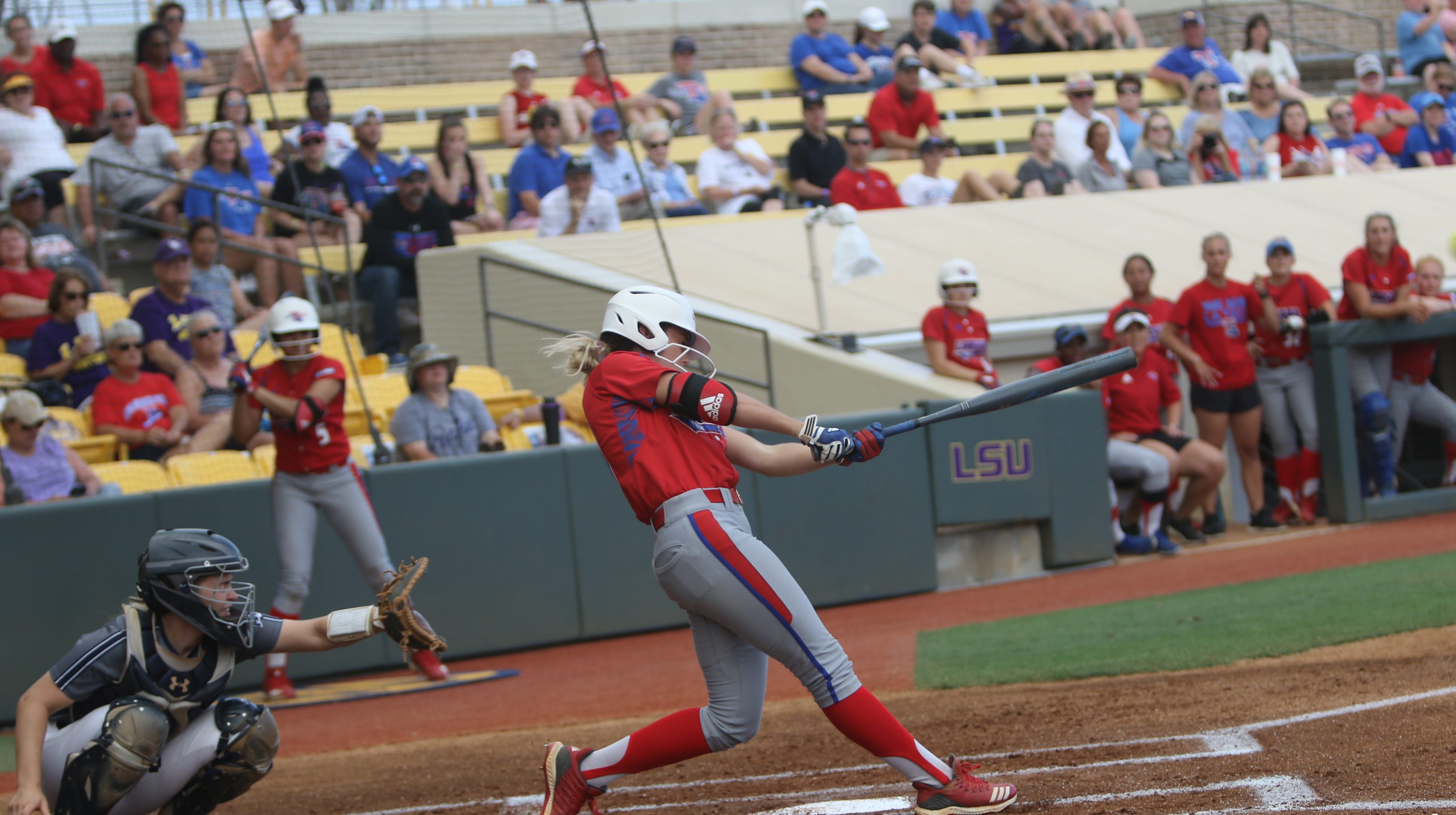 Louisiana Tech senior Morgan Turkoly (21) swings through a pitch against Monmouth Saturday, May 18 during NCAA regionals at Tiger Park on LSU's campus.