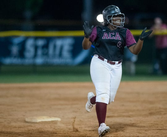 Alabama Christian's Aniya Jackson smiles as she rounds the bases after hitting the go-ahead home run to beat Rogers to win the AHSAA 4A State Softball Championship at Lagoon Park in Montgomery, Ala., on Saturday May 18, 2019.
