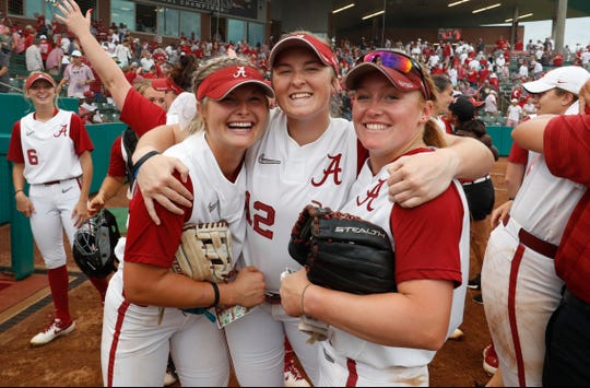 Alabama's KB Sides (8), Kaylee Tow (12) and Merris Schroder (7) celebrate after Sunday's 9-8 win over Arizona State in the Tuscaloosa Regional finale on May 19, 2019 from Rhoads Stadium in Tuscaloosa. (Photo by Robert Sutton/Alabama athletics)