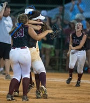 Alabama Christian players celebrate after defeating Rogers for the  AHSAA 4A State Softball Championship at Lagoon Park in Montgomery, Ala., on Saturday May 18, 2019.