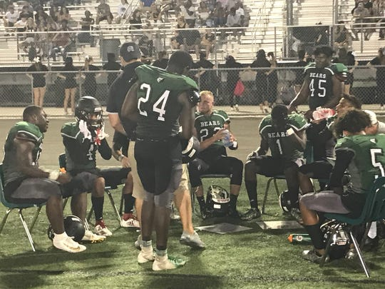 The Palmetto Ridge defense gathers on the sideline after stopping the Key West defense on fourth down during the fourth quarter of Saturday night's 23-6 spring victory.