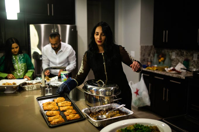 Javeria Ali prepares a Ramadan fast-breaking dinner for her family, friends, and neighbors at her home in Naples on Saturday, May 18, 2019. Ali has been working for days to prepare the meal as she has been fasting daily for Ramadan.