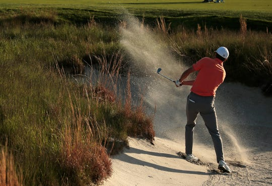 Jordan Spieth hits out of a bunker on the 18th hole during the third round of the PGA Championship golf tournament, Saturday, May 18, 2019, at Bethpage Black in Farmingdale, N.Y.