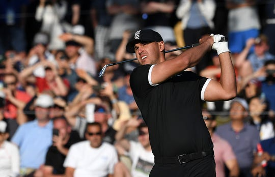 Brooks Koepka of the United States plays a shot from the 17th tee during the third round of the 2019 PGA Championship at the Bethpage Black course on May 18, 2019 in Farmingdale, New York.
