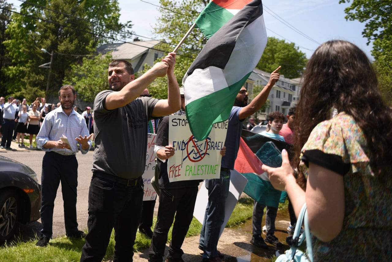 A fundraising event for Magen David Adom, Israel's national EMS organization, was held at Congregation Beth Sholom in Teaneck on Sunday, May 19, 2019. Sayel Kayed, of North Bergen, with flag, and a group of pro-Palestinian supporters, protest outside of the event.