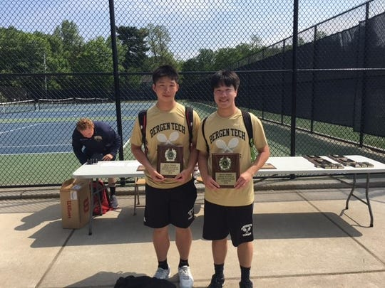 Juniors Darren Lau, left, and Tom Cai of Bergen Tech won the second doubles Bergen County tennis title on Sunday at Northern Valley-Old Tappan High School.