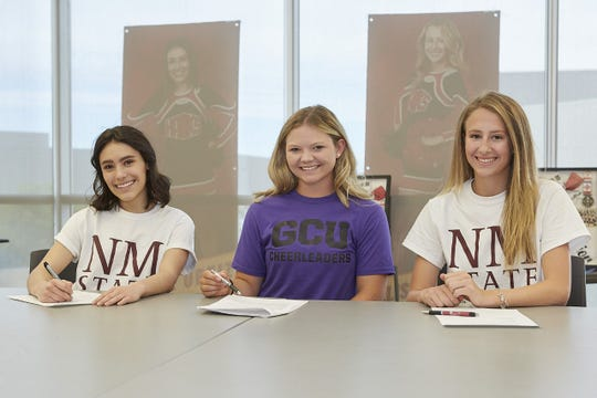 "Centennial cheerleaders, from left, Alexandra ""Lexie"" Ortiz, Chaeley Boykin and Allison Rewalt will cheer at New Mexico State and Grand Canyon universities next year."