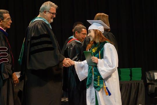 Superintendent Greg Ewing, left, congratulates Valedictorian Renee Batanach at Mayfield High School's commencement on May 18, 2019.